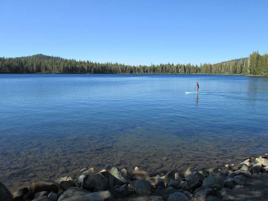 Right along Gold Lake Road in Plumas County: Stand Up Paddleboarding on calm waters of east end of Gold Lake, short drive from Graeagle Photo: Tom Stienstra