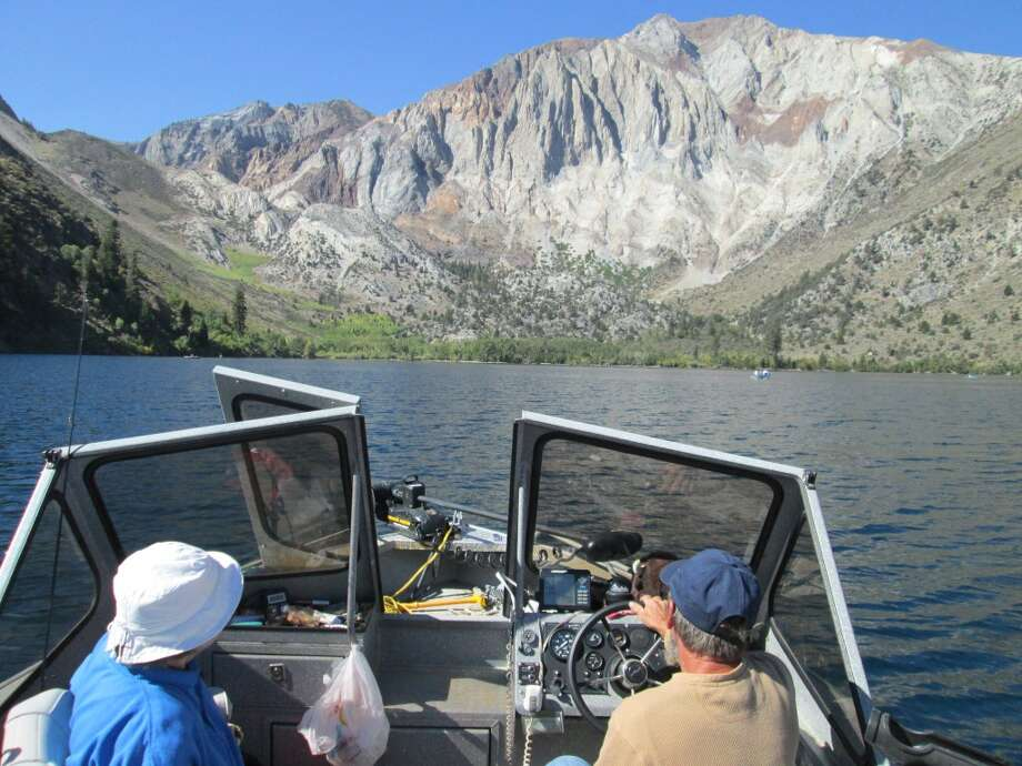 That's Kathie and Dave Morgan on my boat at Convict Lake, one of the prettiest lakes you can drive to in the Eastern Sierra Photo: Tom Stienstra