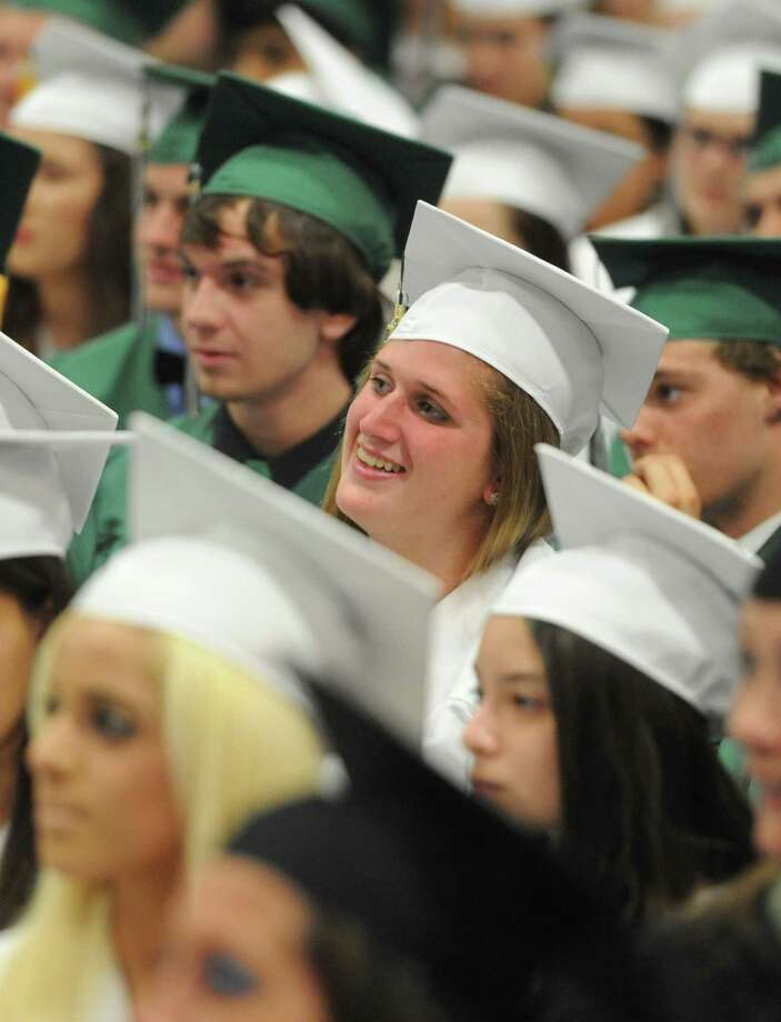 Sarah Fuchs listens during the New Milford High School 2014 Graduation Ceremony at Western Connecticut State University's O'Neill Center in Danbury, Conn. Saturday, June 21, 2014. Photo: Tyler Sizemore / The News-Times