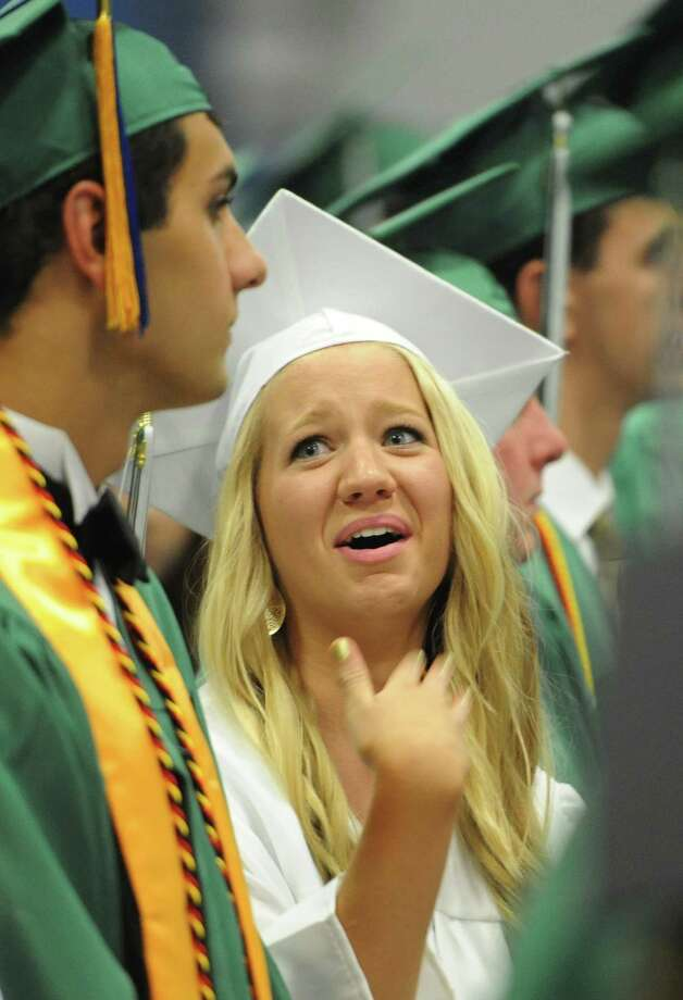 Courtney Quirk talks with a fellow graduate during the New Milford High School 2014 Graduation Ceremony at Western Connecticut State University's O'Neill Center in Danbury, Conn. Saturday, June 21, 2014. Photo: Tyler Sizemore / The News-Times