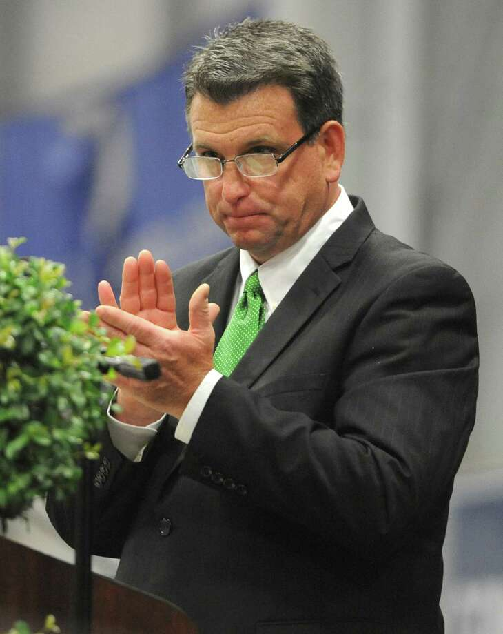 New Milford Principal Greg P. Shugrue speaks at the New Milford High School 2014 Graduation Ceremony at Western Connecticut State University's O'Neill Center in Danbury, Conn. Saturday, June 21, 2014. Photo: Tyler Sizemore / The News-Times