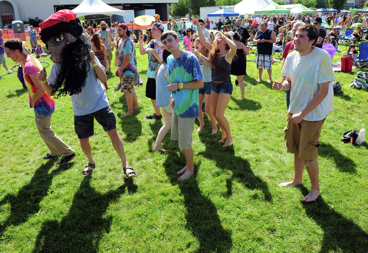 People dance to the music of Jen Durkin and the Business as they perform during the 5th Annual Soupstock Music and Arts Festival in Shelton, Conn. on Saturday June 21, 2014. The festival continues on Sunday from 11-6.