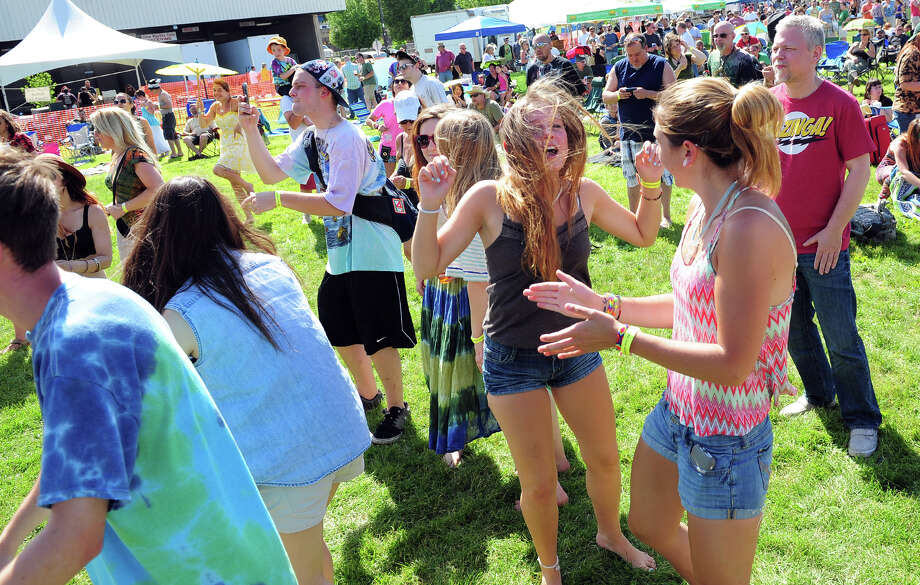 People dance to the music of Jen Durkin and the Business as they perform during the 5th Annual Soupstock Music and Arts Festival in Shelton, Conn. on Saturday June 21, 2014. The festival continues on Sunday from 11-6. Photo: Christian Abraham / Connecticut Post