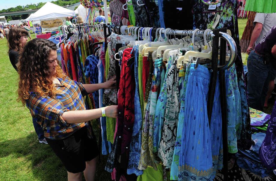 Bianca Brown, of Stamford, looks at dresses, during the 5th Annual Soupstock Music and Arts Festival in Shelton, Conn. on Saturday June 21, 2014. The festival continues on Sunday from 11-6. Photo: Christian Abraham / Connecticut Post