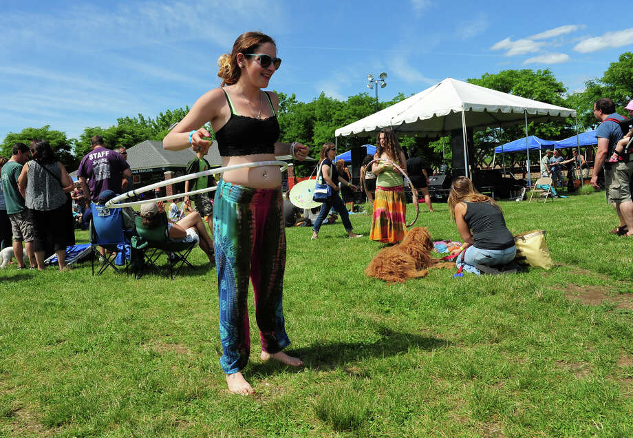 Mallory Mucci plays with a hoola hoop, during the 5th Annual Soupstock Music and Arts Festival in Shelton, Conn. on Saturday June 21, 2014. The festival continues on Sunday from 11-6. Photo: Christian Abraham / Connecticut Post
