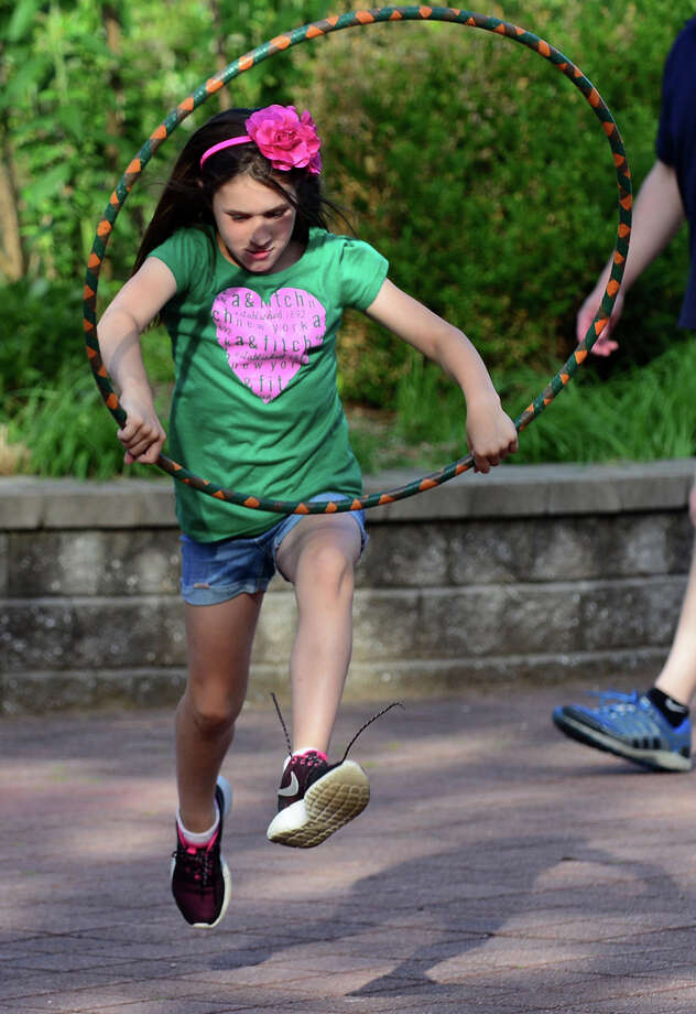 Emily Wildman, 8, skips with a hula hoop, during the 7th Annual Survivor Safari was held for cancer survivors and their families at Beardsley Zoo in Bridgeport, Conn. on Saturday June 21, 2014. The event, which is in its seventh year, was hosted by Bridgeport Hospital's Norma F. Pfriem Cancer Institute. Photo: Christian Abraham / Connecticut Post
