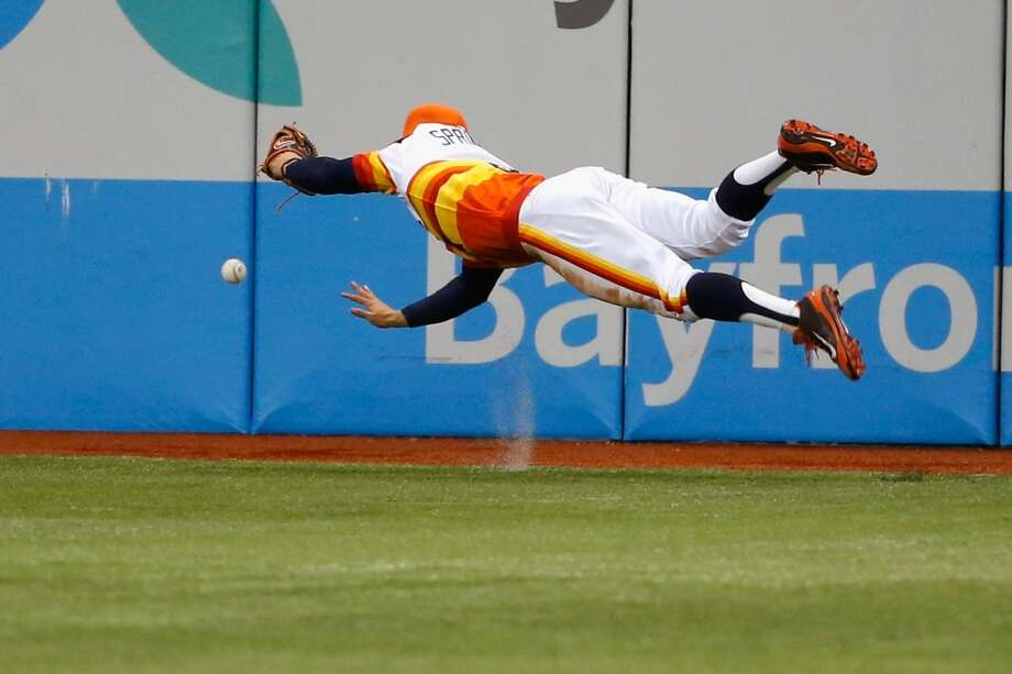 George Springer dives near the wall trying to make the catch of a double from a Matt Joyce in the fifth inning. Photo: Scott Iskowitz, Getty Images