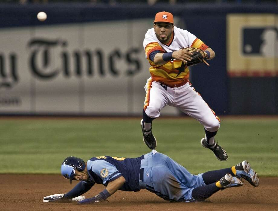 Astros shortstop Marwin Gonzalez, top, leaps over Rays' Desmond Jennings after a force-out at second base during the fourth inning. Photo: Steve Nesius, Associated Press