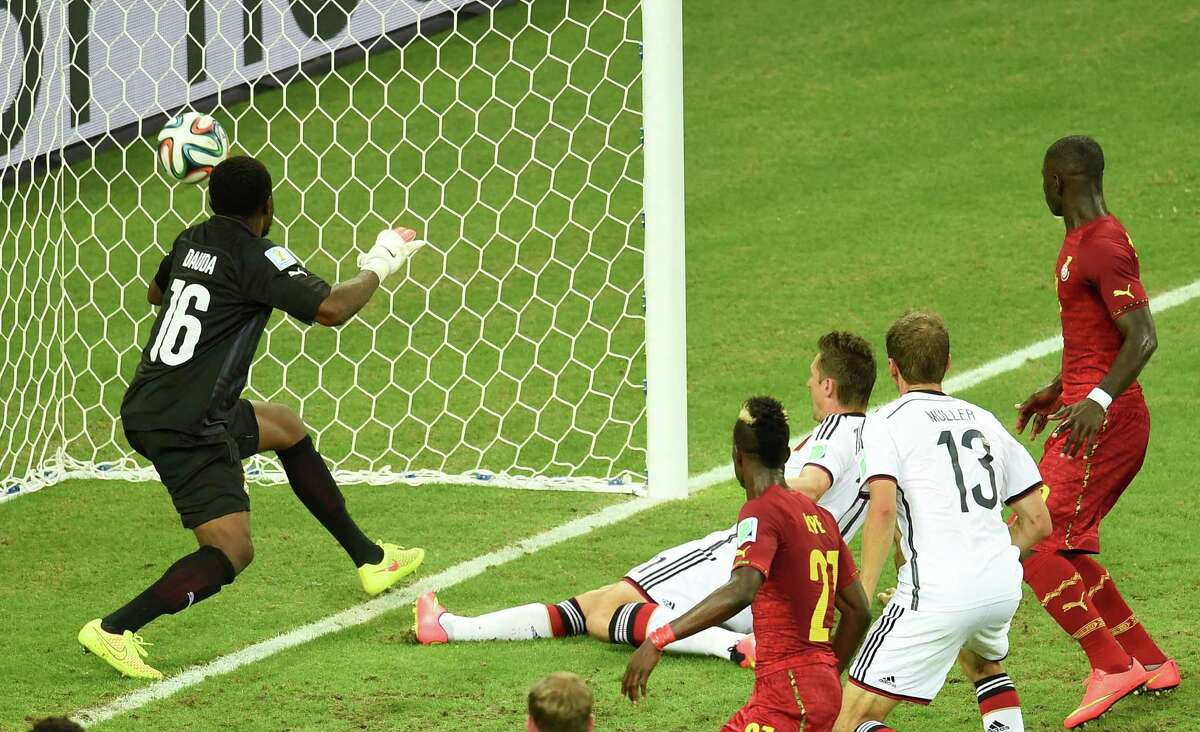 Germany's forward Miroslav Klose (C) scores during a Group G football match between Germany and Ghana at the Castelao Stadium in Fortaleza during the 2014 FIFA World Cup on June 21, 2014. The game ended with a draw 2-2. AFP PHOTO/ EMMANUEL DUNANDEMMANUEL DUNAND/AFP/Getty Images ORG XMIT: 491922365