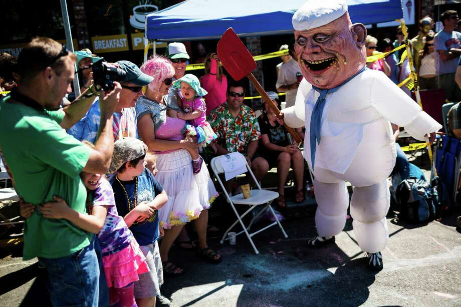 Covered in fake crumbs, a demon-like chef scares children. Photo: JORDAN STEAD, SEATTLEPI.COM / SEATTLEPI.COM