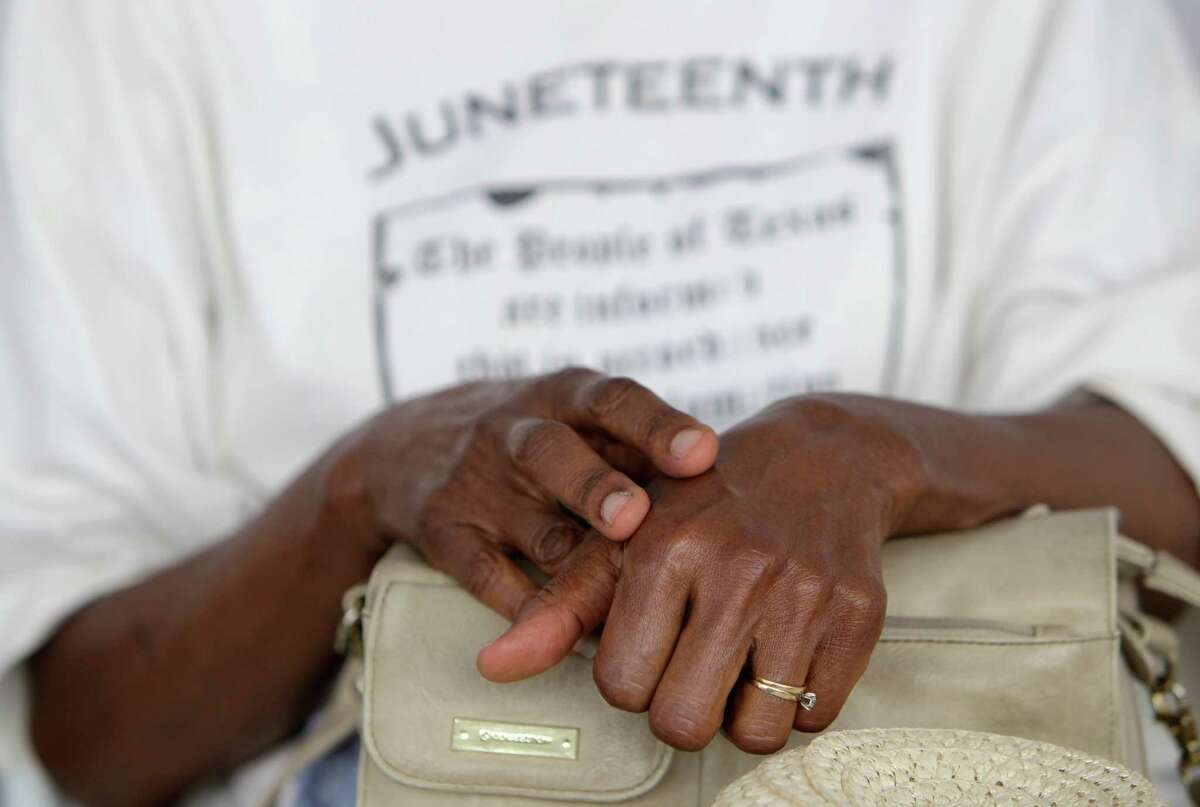 Some among the crowd at Saturday's dedication ceremony paid personal tribute to Juneteenth's significance by wearing clothing in recognition of it.