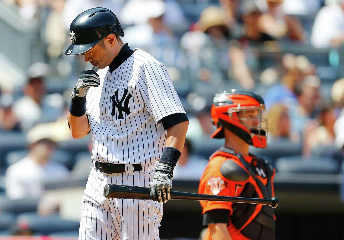 NEW YORK, NY - JUNE 21: Ichiro Suzuki #31 of the New York Yankees reacts after striking out in the fifth inning against the Baltimore Orioles at Yankee Stadium on June 21, 2014 in the Bronx borough of New York City. (Photo by Mike Stobe/Getty Images) ORG XMIT: 477585333