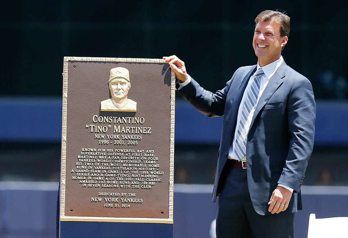 NEW YORK, NY - JUNE 21: Former New York Yankees Tino Martinez unviels a plaque that will be placed in Monument Park during pre-game ceremoney at Yankee Stadium on June 21, 2014 in the Bronx borough of New York City. (Photo by Mike Stobe/Getty Images) ORG XMIT: 477585333