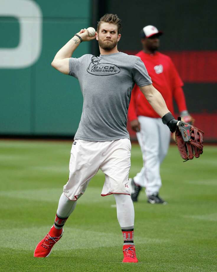 Washington Nationals left fielder Bryce Harper warms up before a baseball game against the Philadelphia Phillies at Nationals Park Tuesday, June 3, 2014, in Washington. (AP Photo/Alex Brandon) Photo: Alex Brandon, STF / AP