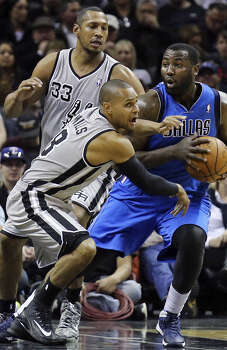 The contracts of Boris Diaw and Patty Mills, seen here defending against the Mavs' DeJuan Blair, both are expiring. Photo: Edward A. Ornelas / Express-News / © 2014 San Antonio Express-News
