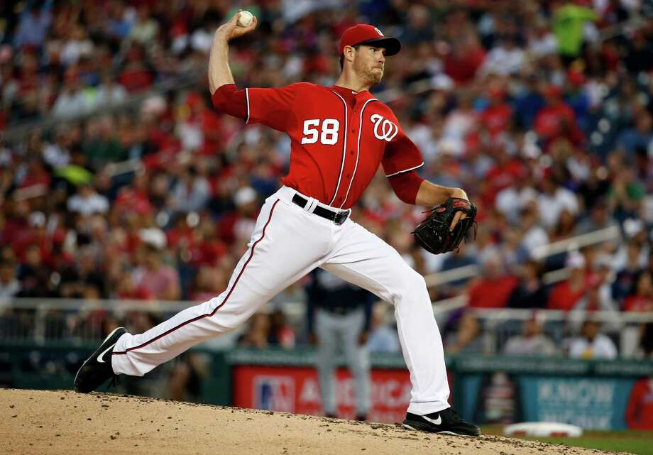 Washington Nationals starting pitcher Doug Fister throws during the third inning of a baseball game against the Atlanta Braves at Nationals Park on Saturday, June 21, 2014, in Washington. (AP Photo/Alex Brandon) ORG XMIT: NAT110 Photo: Alex Brandon / AP