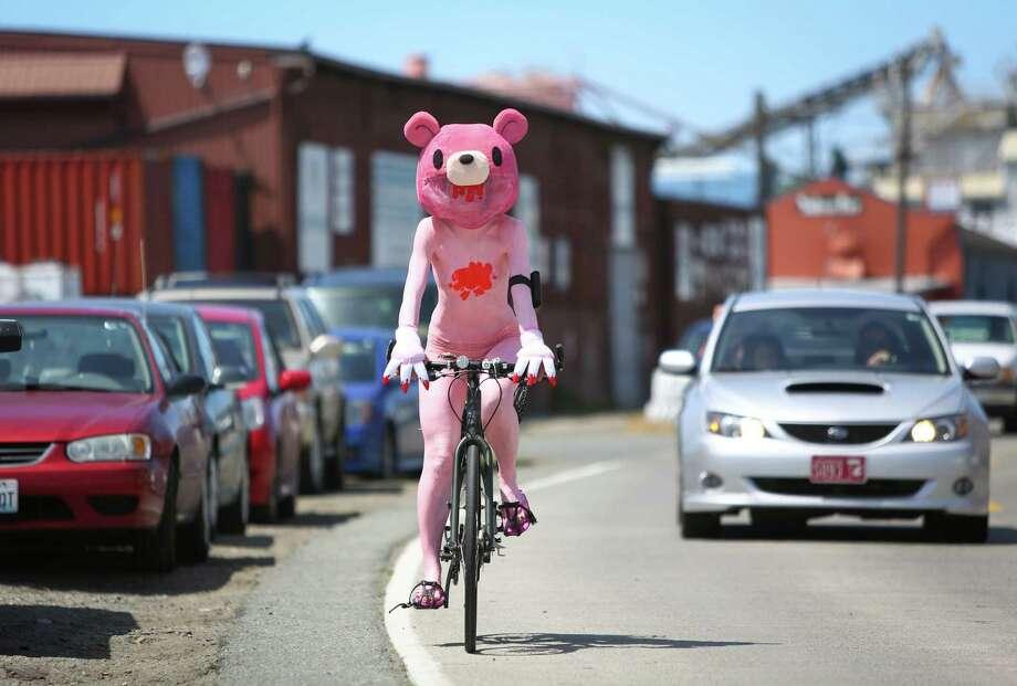 A painted cyclist rides to the parade. Photo: JOSHUA TRUJILLO, SEATTLEPI.COM / SEATTLEPI.COM