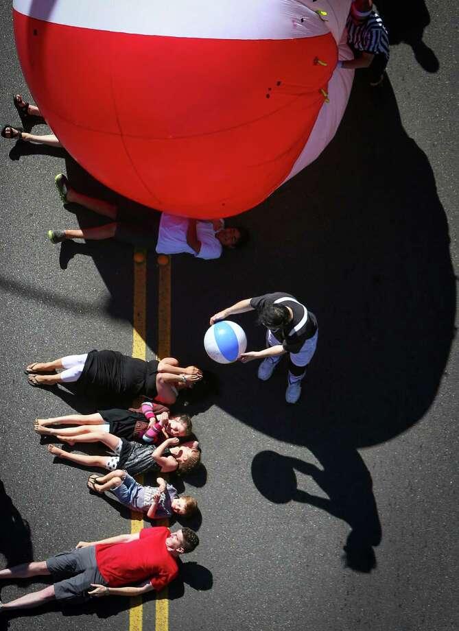 A large inflatable ball rolls over spectators. Photo: JOSHUA TRUJILLO, SEATTLEPI.COM / SEATTLEPI.COM