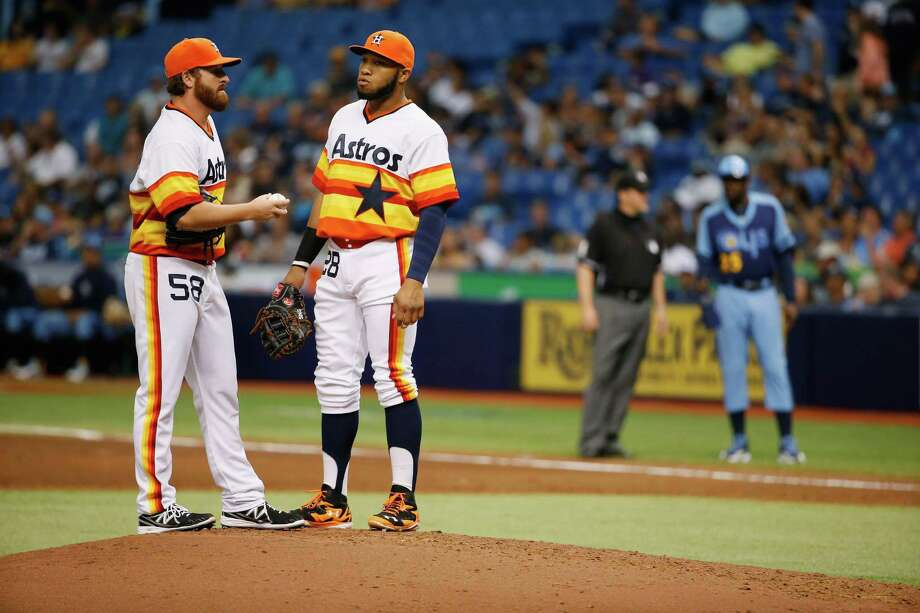 It was a tough Saturday afternoon for Astros first baseman Jon Singleton, right, and starting pitcher Jake Buchanan, who was hit hard in his major league debut. Photo: Scott Iskowitz, Stringer / 2014 Getty Images
