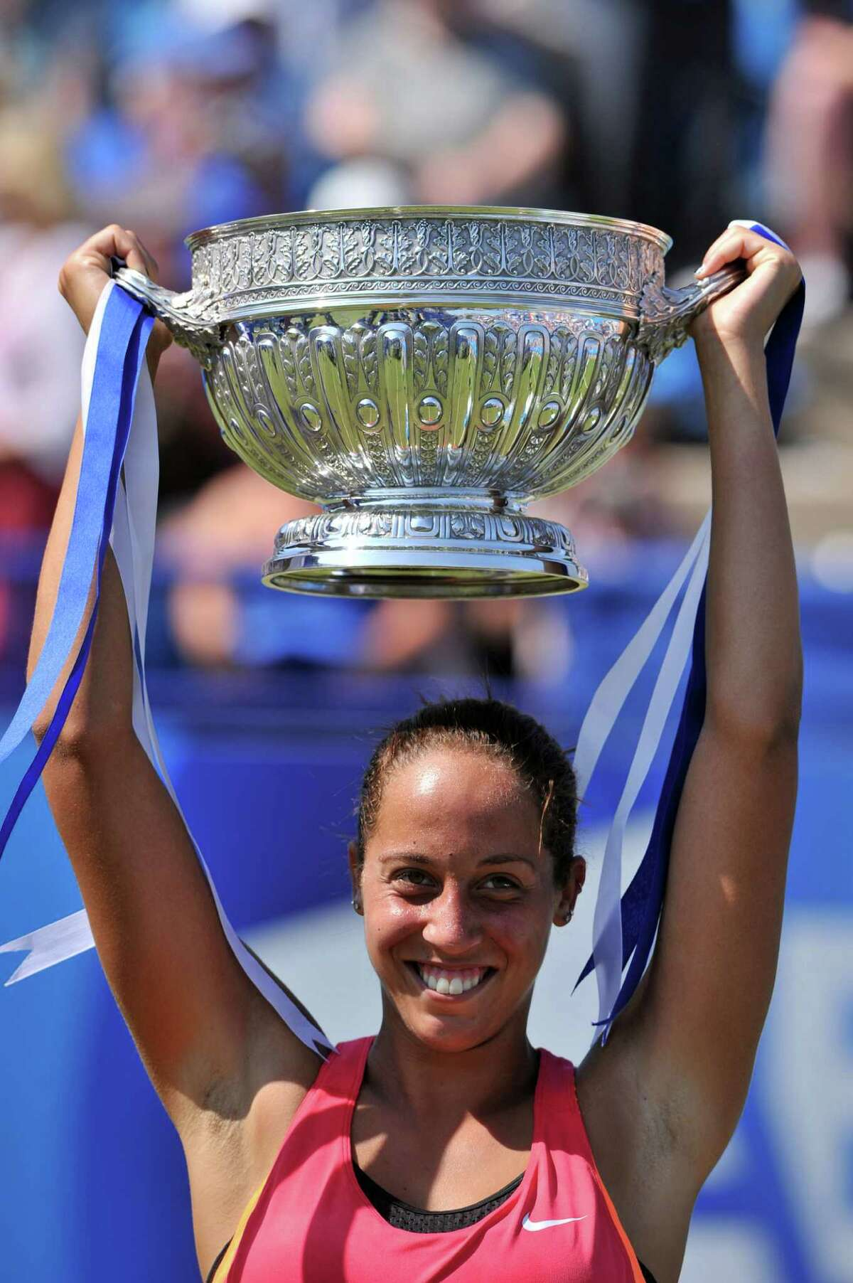 Madison Keys of the US celebrates with the trophy after winning the women's singles final match against Germany's Angelique Kerber on the eighth day of the Aegon International tennis tournament in Eastbourne, southern England on June 21, 2014. Keys won 6-3, 3-6, 7-5. AFP PHOTO / GLYN KIRKGLYN KIRK/AFP/Getty Images