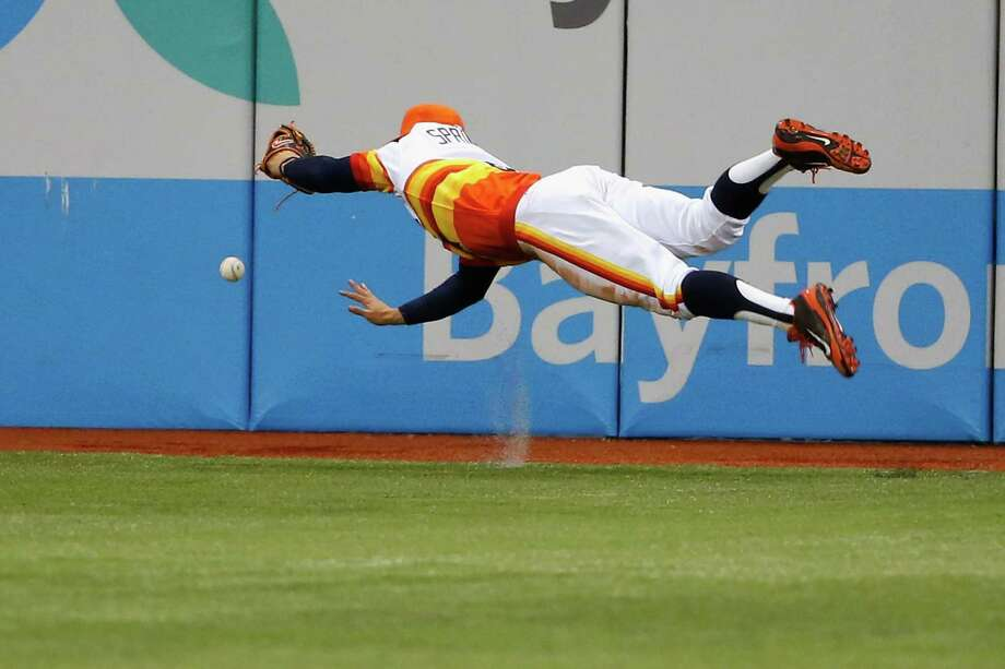 Astros right fielder George Springer dives in vain while trying to come up with a ball hit by the Rays' Matt Joyce that went for an RBI double in the fifth inning of Saturday's game. Photo: Scott Iskowitz, Stringer / 2014 Getty Images