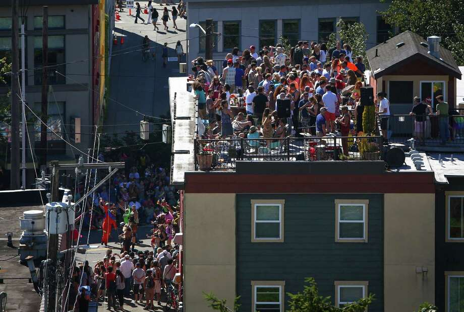 Spectators watch from a rooftop. Photo: JOSHUA TRUJILLO, SEATTLEPI.COM / SEATTLEPI.COM