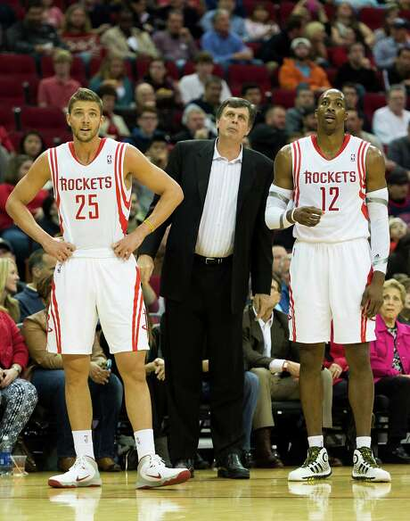 While Knicks forward Carmelo Anthony, left, is among the most highly sought free agents this summer, general manager Daryl Morey remains hopeful the Rockets can find a late-round draft steal this week like they previously got in small forward Chandler Parsons, right. Photo: Smiley N. Pool, Staff / © 2013  Houston Chronicle