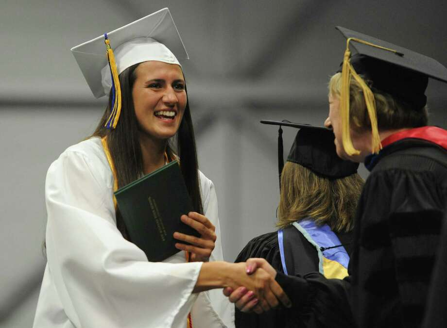 Photos from the New Milford High School 2014 Graduation Ceremony at Western Connecticut State University's O'Neill Center in Danbury, Conn. Saturday, June 21, 2014. Photo: Tyler Sizemore / The News-Times
