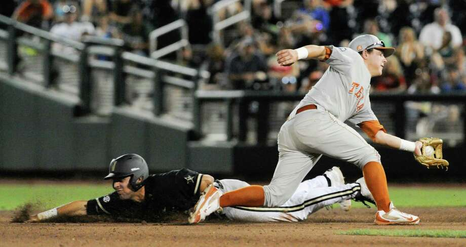 Vanderbilt's Vince Conde, left, steals second base ahead of the throw to Texas second baseman Brooks Marlow, right, in the seventh inning of an NCAA baseball College World Series game in Omaha, Neb., Saturday, June 21, 2014. (AP Photo/Eric Francis) Photo: Eric Francis, Associated Press / FR9944 AP