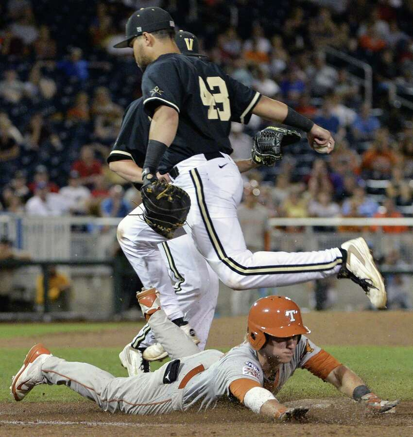 Texas' Madison Carter slides into first base in vain as Vanderbilt's Zander Wiel makes the put-out in the ninth inning of the Commodores' 4-3 win in 10 innings, eliminating UT one game shy of the CWS finals.