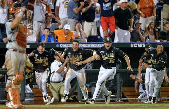Vanderbilt players dash from the dugout as a single by Tyler Campbell in the 10th inning scored Rhett Wiseman for a 4-3 win over Texas in an NCAA baseball College World Series game in Omaha, Neb., Saturday, June 21, 2014. Vanderbilt advances to the championship series. (AP Photo/Ted Kirk) Photo: Ted Kirk, Associated Press / FR34398 AP