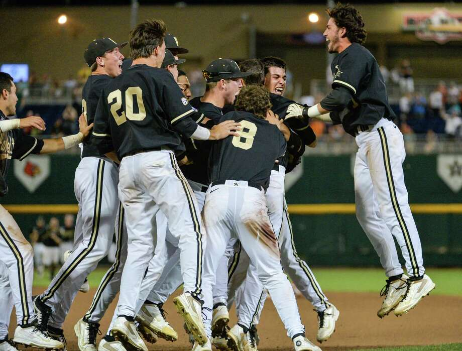 Vanderbilt players celebrate after a single by Tyler Campbell in the 10th inning scored Rhett Wiseman for a 4-3 win over Texas in an NCAA baseball College World Series game in Omaha, Neb., Saturday, June 21, 2014. Vanderbilt advances to the championship series.  (AP Photo/Ted Kirk) Photo: Ted Kirk, Associated Press / FR34398 AP