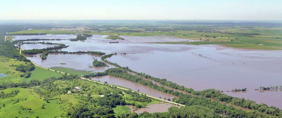 This aerial photo shows Big Sioux River floodwaters encroach upon Iowa Highway 12 north of Sioux City, Iowa Friday, June 20, 2014. The Big Sioux River crested earlier and at lower than expected flood levels. Photo: Tim Hynds, AP  / The Sioux City Journal