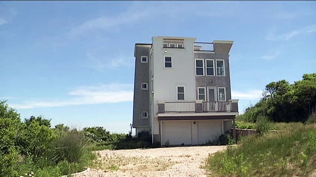 This June 16, 2014 photo shows $1.8 million waterfront house that a developer mistakenly built on park land in Narragansett, R.I., and which the Rhode Island Supreme Court has ordered it be removed. Construction began in 2009, but the developer didn't discover the error until 2011 when attempting to sell it. A foundation had been set up to preserve the property as a park in perpetuity, and the developer was told the land was not for sale.