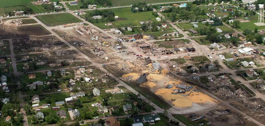 This aerial photo shows debris and damage after a tornado destroyed many buildings in Pilger, Neb., on Tuesday, June 17, 2014.  Nebraska's governor and some residents express confidence that the tiny, 350-person farming town of Pilger will be rebuilt, despite the tornado that leveled much of it Monday. (AP Photo/The World-Herald, Matt Miller)  Photo: MATT MILLER, AP  / OMAHA WORLD-HERALD2014