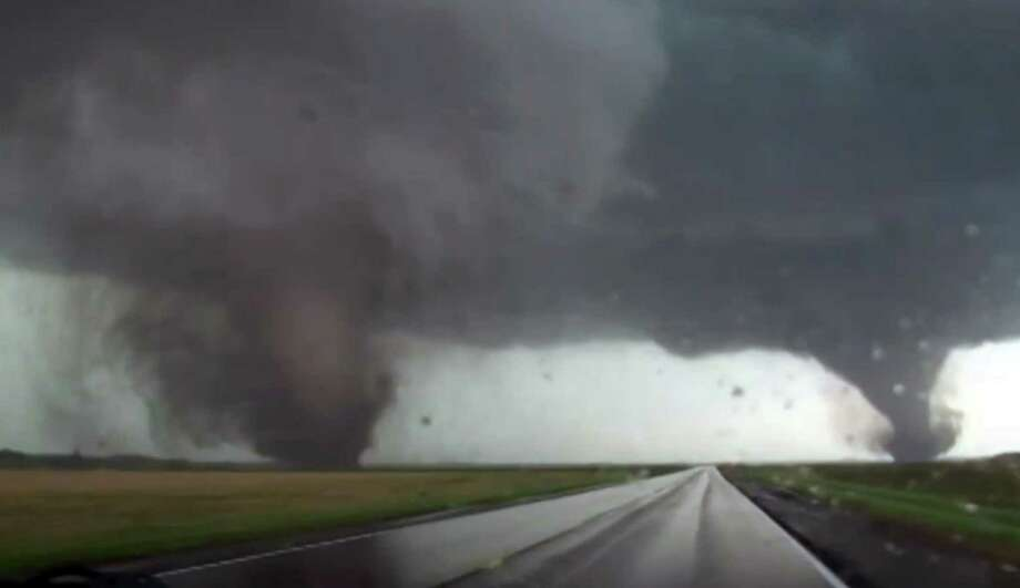 This framgrab taken from video provided by StormChasingVideo.com shows two tornados approaching Pilger, Neb., Monday June 16, 2014.  The National Weather Service said at least two twisters touched down within roughly a mile of each other Monday in northeast Nebraska. Photo: StormChasingVideo.com, AP  / AP2014