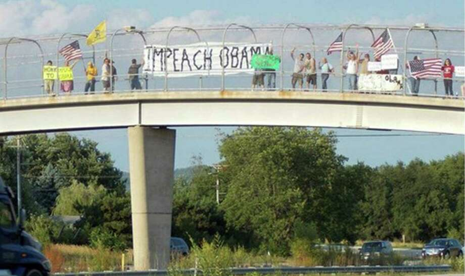 In this photo provided by the Thomas More Law Center protesters assemble on an Interstate 90 overpass in the town of Campbell, Wis. The town subsequently adopted an ordinance banning signs on the overpass, leading to a bitter dispute between a local tea party activist and Campbell Police Chief Tim Kelemen. Photo: AP  / Thomas More Law Center