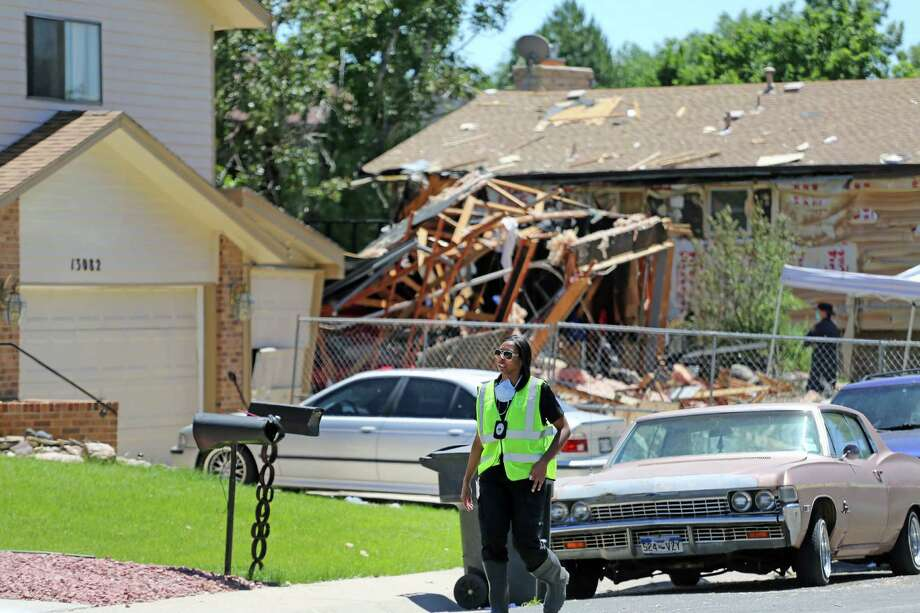 A police officer walks at the scene where an explosion the previous evening leveled a home and blew out neighbors' windows, in the Denver suburb of Thornton, Colo., Friday June 20, 2014. The cause of the explosion is under investigation. Photo: Brennan Linsley, AP  / AP