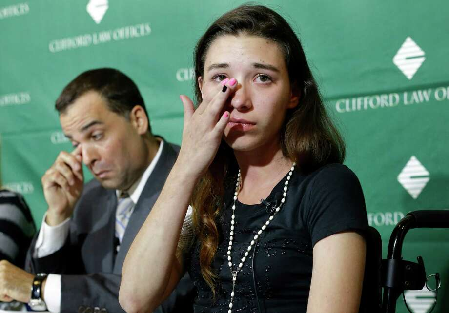 Injured circus acrobat Julissa Segrera, of the U.S., right, wipes away a tear while speaking with reporters as attorney Michael Krzak, left, wipes his eye during a news conference at Spaulding Rehabilitation Hospital, Tuesday, June 17, 2014, in Boston. Eight acrobats were injured during a May 4, 2014 performance of the Ringling Bros. and Barnum & Bailey Circus in Providence, R.I., when the apparatus from which they were suspended fell, sending them plummeting to the ground.Related story: Circus acrobats plan suit, say lives have changed Photo: Steven Senne, AP  / AP
