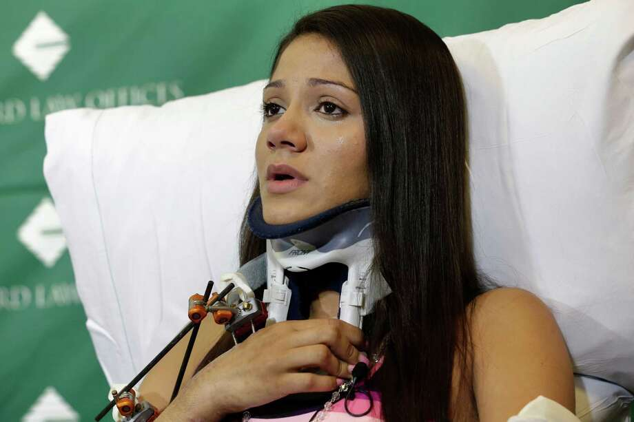 Injured circus acrobat Dayana Costa, of Brazil, is tearful while addressing members of the media during a news conference at Spaulding Rehabilitation Hospital, Tuesday, June 17, 2014, in Boston. Eight acrobats were injured during a May 4, 2014 performance of the Ringling Bros. and Barnum & Bailey Circus in Providence, R.I., when the apparatus from which they were suspended fell, sending them plummeting to the ground.Related story: Circus acrobats plan suit, say lives have changed Photo: Steven Senne, AP  / AP