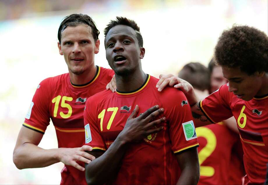Belgium's Divock Origi, centre, celebrates with Belgium's Daniel Van Buyten, left, and Belgium's Axel Witsel, right, after Origi scored the opening goal during the group H World Cup soccer match between Belgium and Russia at the Maracana stadium in Rio de Janeiro, Brazil, Sunday, June 22, 2014. (AP Photo/Ivan Sekretarev) Photo: Ivan Sekretarev, Associated Press / AP