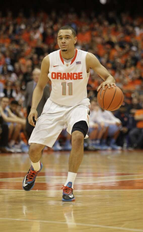 Tyler Ennis  Position: Guard  Ht./Wt: 6-2/180 lbs  School: Syracuse  Classification: Freshman   2013-14 stats: 13 points, three rebounds, six assists per game Photo: Nick Lisi, Associated Press