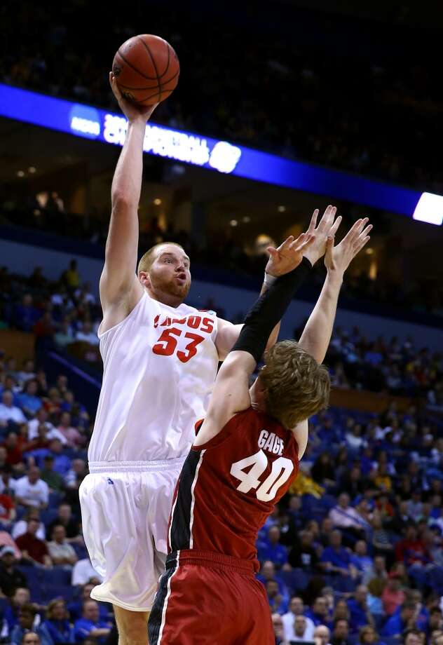 Alex Kirk  Position: Center  Ht./Wt: 7-0/245 lbs  School: New Mexico  Classification: Junior  2013-14 stats: 13 points, nine rebounds, three blocks, 1 assist per game Photo: Andy Lyons, Getty Images