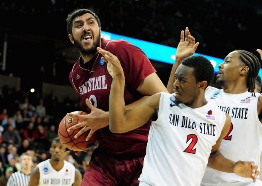 Sim Bhullar  Position: Center  Ht./Wt: 7-5/360 lbs  School: New Mexico State   Classification: Sophomore  2013-14 stats: 10 points, eight rebounds, one assist, three blocks per game Photo: Steve Dykes, Getty Images