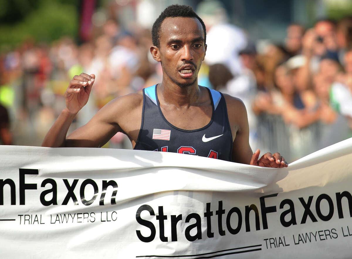 Ethiopian Wegi Habtamu Arga breaks the tape at 1:05:31 to win the Fairfield Half Marathon at Jennings Beach in Fairfield, Conn. on Sunday, June 22, 2014.