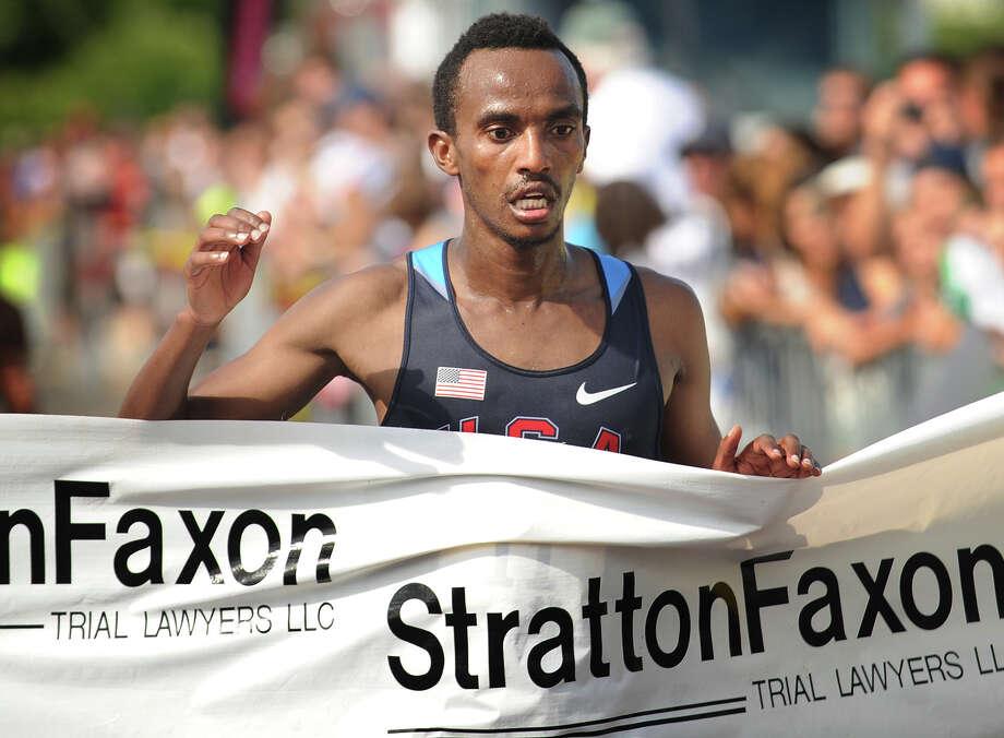 Ethiopian Wegi Habtamu Arga breaks the tape at 1:05:31 to win the Fairfield Half Marathon at Jennings Beach in Fairfield, Conn. on Sunday, June 22, 2014. Photo: Brian A. Pounds / Connecticut Post