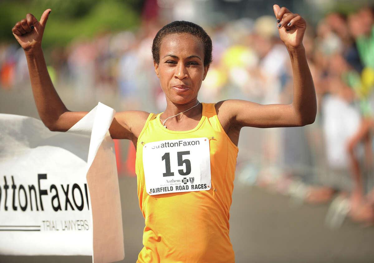 Ethiopian Askale Merachi crosses the finish line in 1:17:47 as the women's winner of the Fairfield Half Marathon at Jennings Beach in Fairfield, Conn. on Sunday, June 22, 2014.