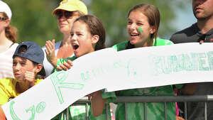 Spectators cheer runners to the finish of the Fairfield Half Marathon at Jennings Beach in Fairfield, Conn. on Sunday, June 22, 2014.
