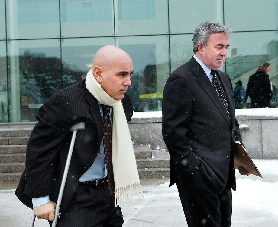 Giovanni Cucullo, 41, of Yonkers, N.Y., left, leaves Stamford Criminal Court after his arraignment for second-degree manslaughter with a motor vehicle in the death of Maryann Loprete, 27, of Bedford Street, Stamford.  Loprete was a passenger in the 2009 BMW 328i sedan Cucullo was driving when the car struck a tree on High Ridge Road near Cedar Wood Road in North Stamford, Jan. 28th, 2010. At right is Cucullo's attorney, Michael Sherman, right, Tuesday, Feb. 16th, 2010. Photo: Bob Luckey / Stamford Advocate