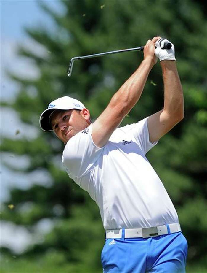 Sergio Garcia, of Spain, watches his tee shot on the second hole during the final round of the Travelers Championship golf tournament in Cromwell, Conn., Sunday, June 22, 2014. (AP Photo/Fred Beckham)